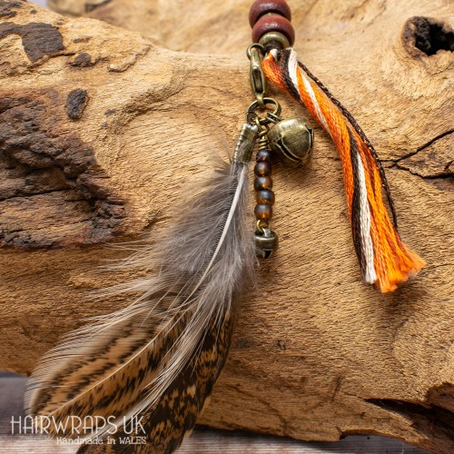 Bell and Amber Bead Feather Dangle Charm.