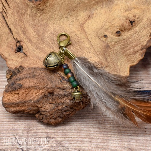 Bell and Green Bead Feather Dangle Charm.