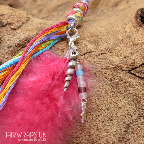 Unicorn Horn and Dangle Feather Charm.